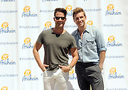 SoCal natives and designers Nate Berkus and Jeremiah Brent, right, celebrate the launch of #VisitAnaheim and the city's revitalization campaign, Wednesday, June 24, 2015, in New York.  Brought to life by renowned 3D street artist Joe Hill, Anaheim is home to some of California's most exciting attractions, entertainment and sports venues, theme parks and brew scene. To learn more go to www.visitanaheim.org.  (Photo by Diane Bondareff/Invision for Visit Anaheim)