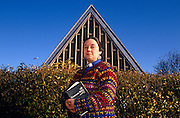 Feminist theologian, writer and Anglican priest Jan Fortune-Wood outside her St Barnabas Church in Kingshurst.