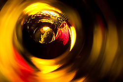 """""""Beauty at the Bottom: Red Wine 5"""" - This is a photograph of a red wine bottle bottle, shot right down inside the mouth of the bottle."""
