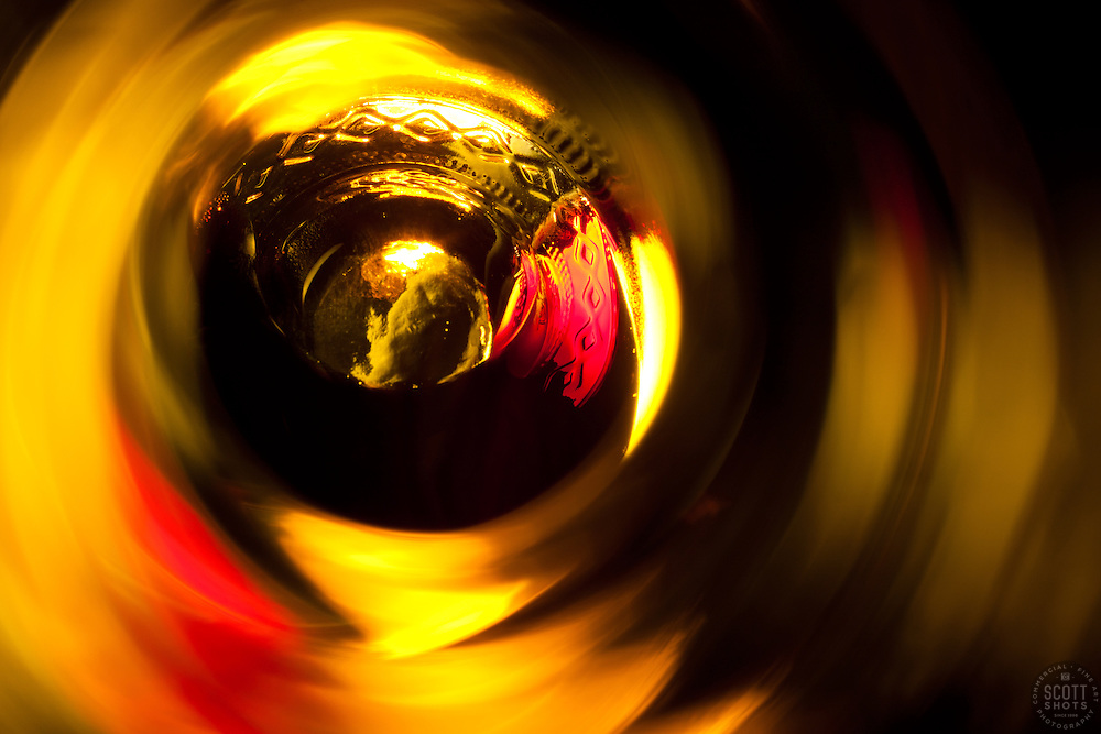 """Beauty at the Bottom: Red Wine 5"" - This is a photograph of a red wine bottle bottle, shot right down inside the mouth of the bottle."