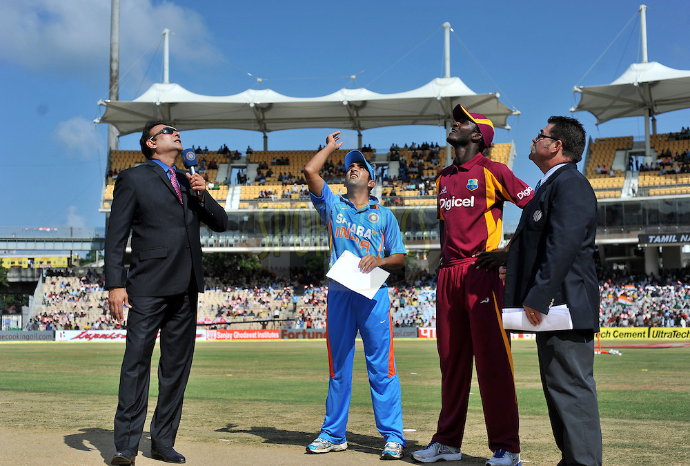 Gautam Gambhir of India and Darren Sammy captain of West Indies during the toss before the start of the 5th ODI ( One Day International ) match between India and The West Indies held at The MA Chidambaram Cricket Stadium in Chennai, India on the 11th December 2011..Photo by Pal Pillai/BCCI/SPORTZPICS