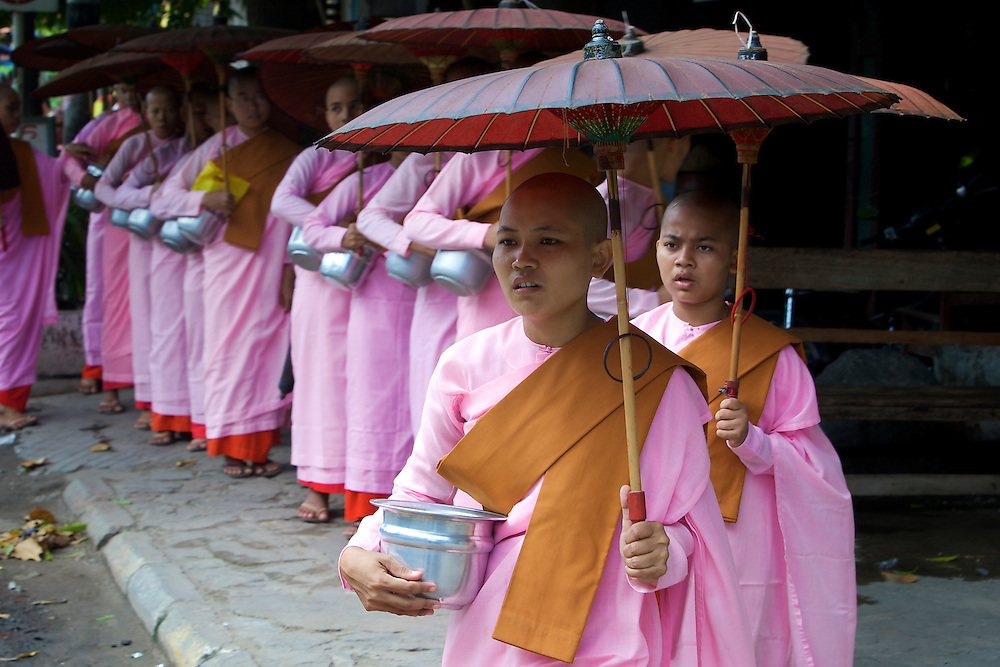 Young nuns collecting alms, Mandalay, Myanmar.