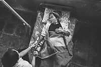 A woman with TB is treated by a nurse in northern Shan State, Myanmar.