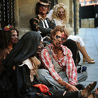 "Actors dressed up like zombies wait for tram, on September 2, 2010, in the Northern Spanish city of Bilbao. Actors and dancers, dressed up like zombies, visited Bilbao to promote the musical show ""Forever, King of Pop"", based on Michael Jackson's ""Thriller"".  PHOTO/Rafa Rivas"