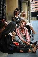 """Actors dressed up like zombies wait for tram, on September 2, 2010, in the Northern Spanish city of Bilbao. Actors and dancers, dressed up like zombies, visited Bilbao to promote the musical show """"Forever, King of Pop"""", based on Michael Jackson's """"Thriller"""".  PHOTO/Rafa Rivas"""