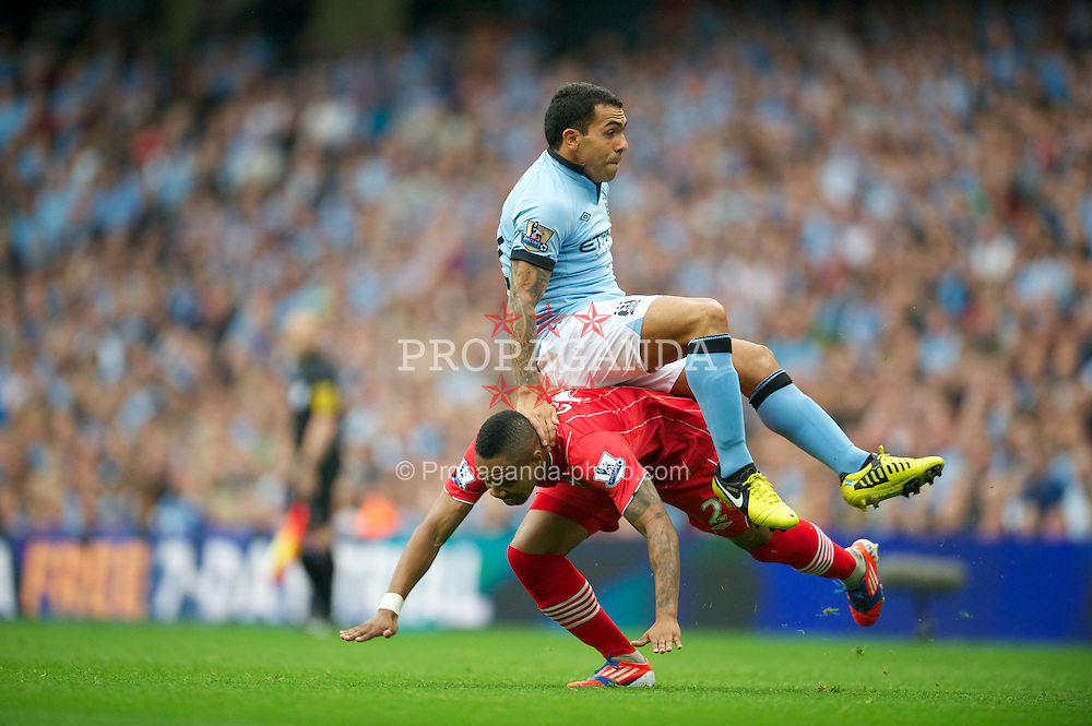 MANCHESTER, ENGLAND - Sunday, August 19, 2012: Manchester City's Carlos Tevez in action against Southampton's Nathaniel Clyne during the Premiership match at the City of Manchester Stadium. (Pic by David Rawcliffe/Propaganda)