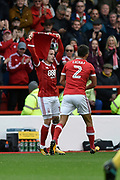"Nottingham Forest midfielder Barrie McKay (10) celebrates scoring a goal, making the score 1-0, and holds up a shirt with ""Dylan"" on the back, during the EFL Sky Bet Championship match between Nottingham Forest and Burton Albion at the City Ground, Nottingham, England on 21 October 2017. Photo by Richard Holmes."