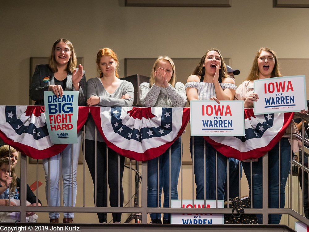 20 OCTOBER 2019 - INDIANOLA, IOWA: Students at Simpson College in Indianola, IA, cheer during a campaign speech by US Senator Elizabeth Warren (D-MA) Sunday. Sen. Warren is campaigning to be the Democratic nominee for the US presidency in Iowa this week. Iowa traditionally hosts the the first selection event of the presidential election cycle. The Iowa Caucuses will be on Feb. 3, 2020.                PHOTO BY JACK KURTZ