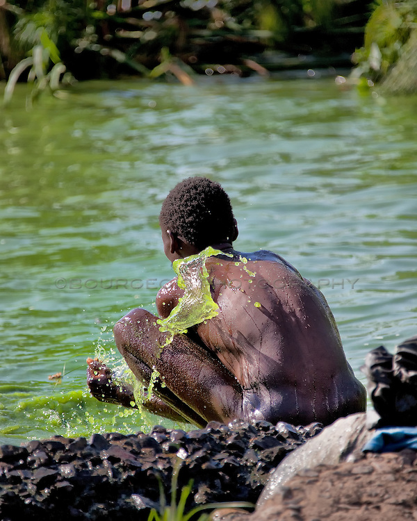 Man bathing on Lake Victoria, near Homa Bay