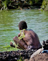 Man bathing on Lake Victoria, near Homa Bay