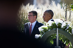 September 11, 2016 - Arlington, United States of America - U.S President Barack Obama and Defense Secretary Ashton Carter stand in silence after placing a wreath at the memorial during a ceremony commemorating the 15th anniversary of the 9/11 terrorist attacks at the Pentagon September 11, 2016 in Arlington, Virginia. (Credit Image: © Ej Hersom/Planet Pix via ZUMA Wire)