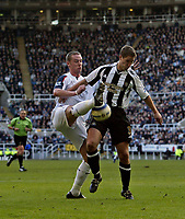 Photo: Andrew Unwin.<br />Newcastle United v Bolton Wanderers. The Barclays Premiership. 04/03/2006.<br />Bolton's Kevin Nolan (L) challenges Newcastle's Robbie Elliott.