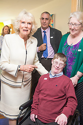 In the image - The Duchess meeting 28 yr old Christopher Horth.<br /> HRH The Duchess of Cornwall, Patron of Helen & Douglas House Hospice visits Douglas House to celebrate their 10th Anniversary. The Hospice cares for children and young adults with life shortening conditions, United Kingdom, Friday, 9th May 2014. Picture by i-Images