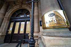 Edinburgh, Scotland, UK. 29 March, 2020. Life in Edinburgh on the first Sunday of the Coronavirus lockdown. Streets deserted, shops and restaurants closed, very little traffic on streets and reduced public transport. Pictured; Balmoral Hotel on Princes Street is closed and boarded up. Iain Masterton/Alamy Live News
