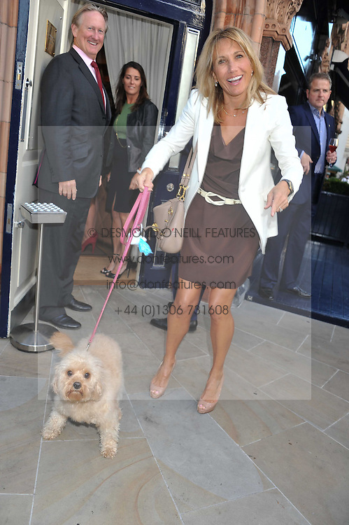 MARCI DECLARIS and her dog Annabel at the 10th anniversary of George in association with The Dog's Trust held at George, 87-88 Mount Street, Mayfair, London on 13th September 2011.
