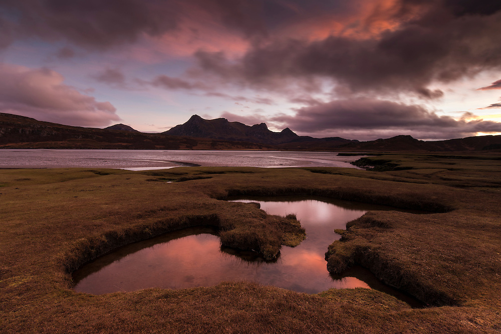 Saltmarsh exposed by low tide at sunset, Kyle of Tongue, Sutherland.