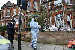 © Licensed to London News Pictures. 25/01/2020. London, UK. A forensic officer outside a property on Mount Pleasant Road in Clapton, East London. Police launch a murder investigation at a residential property following fatal stabbing after 11pm on Friday 24 January following reports of a disturbance. A man was found with stab injuries inside the property and died later. A 27 year old man was arrested at the scene on suspicion of murder. Photo credit: Dinendra Haria/LNP