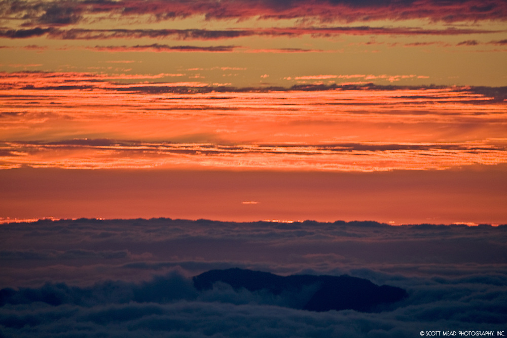 Orange clouds at twilight, from Mauna Kea, Big Island, Hawaii
