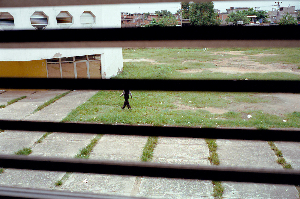 View of school grounds of Vigario Geral and Parada des Lucas. The field adjoins a dirt track that is commonly known as the Gaza strip because of the frequent cross fires in this area. During these shoot outs children in the classroom have to run into the hallway for protection. Rio de Janerio, Brazil. 2001