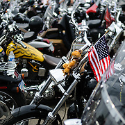 An American flag is mounted on the handlebars of a bike parked before the annual Rolling Thunder motorcycle rally through downtown Washington DC on May 29, 2011. This shot was taken as the riders were leaving the staging area in the Pentagon's north parking lot, where thousands of bikes and riders had gathered.