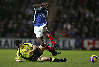 Photo: Lee Earle.<br /> Portsmouth v Manchester City. The Barclays Premiership. 10/02/2007.City's Joey Barton (L) slides in on Djimi Traore.