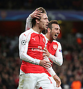 Arsenal defender Nacho Monreal celebrating with Arsenal midfielder Santi Carzola during the Champions League match between Arsenal and Dinamo Zagreb at the Emirates Stadium, London, England on 24 November 2015. Photo by Matthew Redman.