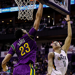 Feb 8, 2017; New Orleans, LA, USA; Utah Jazz guard Dante Exum (11) has his shot blocked by New Orleans Pelicans forward Anthony Davis (23) during the second half of a game at the Smoothie King Center. The Jazz defeated the Pelicans 127-94.  Mandatory Credit: Derick E. Hingle-USA TODAY Sports
