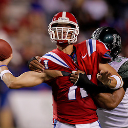 Sep 30, 2009; Ruston, LA, USA; Hawaii Warriors offensive lineman Joey Lipp (58) grabs Louisiana Tech Bulldogs quarterback Ross Jenkins (11) as he attempts a throw in the second half at Joe Aillet Stadium. Louisiana Tech defeated Hawaii 27-6. Mandatory Credit: Derick E. Hingle-US PRESSWIRE