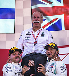 May 12, 2019 - Barcelona, Catalonia, Spain - VALTTERI BOTTAS (FIN) and LEWIS HAMILTON (UK) from team Mercedes shoulder Mercedes-Benz CEO DIETER ZETSCHE as they celebrate their team victory at the Spanish GP on the podium at the Circuit de Barcelona - Catalunya (Credit Image: © Matthias Oesterle/ZUMA Wire)