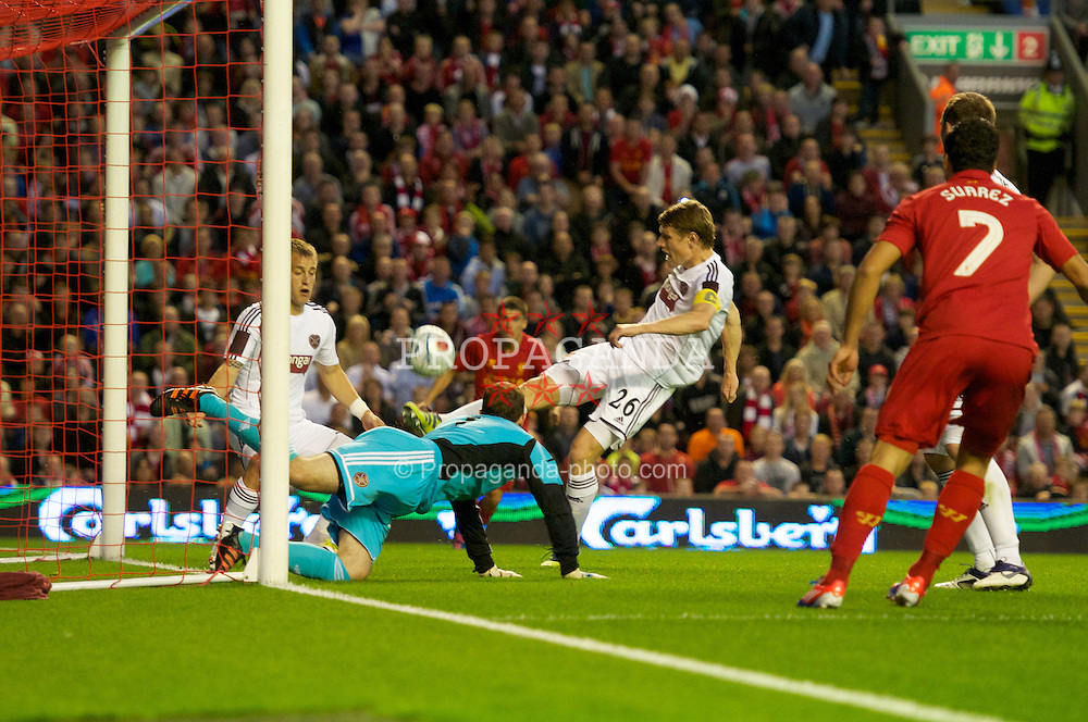 LIVERPOOL, ENGLAND - Thursday, August 30, 2012: Heart of Midlothian's Marius Zaliukas clears the ball off the line during the UEFA Europa League Play-Off Round 2nd Leg match against Liverpool at Anfield. (Pic by Jed Wee/Propaganda)