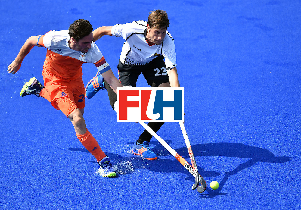 Netherlands' Robert van der Horst (L) vies with Germany's Florian Fuchs during the men's Bronze medal field hockey Netherlands vs Germany match of the Rio 2016 Olympics Games at the Olympic Hockey Centre in Rio de Janeiro on August 18, 2016. / AFP / MANAN VATSYAYANA        (Photo credit should read MANAN VATSYAYANA/AFP/Getty Images)