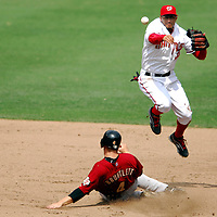 18 July 2007:  Washington Nationals shortstop Felipe Lopez (2) leaps and completes a double play as Houston Astros shortstop Eric Bruntlett (4) slides into second base on a ball hit by pinch hitter Orlando Palmeiro.  The Nationals defeated the Astros 7-6 at RFK Stadium in Washington, D.C.  ****For Editorial Use Only****