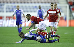 Wigan Athletic's Lee Evans (left) and Bristol City's Marlon Pack (right) battle for the ball during the Sky Bet Championship match at the DW Stadium, Wigan.