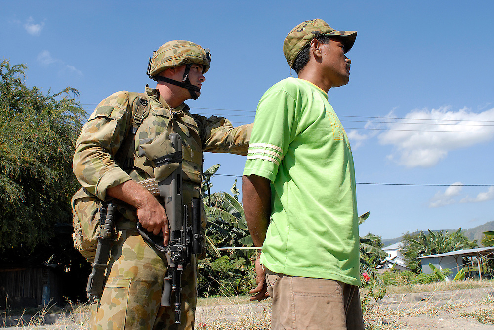 Australian soldiers patrol the Comora area of Dili, a hot point for clashes between rival gangs, the ( Lorosae) and the Westerners (Loromonu). Their aim is to keep the peace, disarming and detaining gang members in order to avoid further clashes. 05/06/06