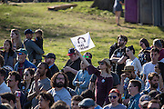 "Brooklyn, NY - 17 April 2016. A supporter in the crowd waves a banner reading ""Feel the Bern"", one of his campaign slogans. Vermont Senator Bernie Sanders, who is running as a Democrat in the U.S. Presidential primary elections, held a campaign ""get out the  vote"" rally in Brooklyn's Prospect Park."