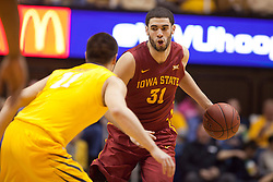 Iowa State Cyclones forward Georges Niang looks to get by West Virginia Mountaineers guard Nathan Adrian (11) during the second half at the WVU Coliseum.
