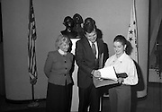 Presentation Of Donnelly Visas.  (R71)..1988..19.01.1988..01.19.1988..19th January 1988..As part of his interest in Ireland Congressman Brian Donnelly promoted a visa scheme to easily allow Irish people entry into America. Known now as the Donnelly Visas,Congressman Donnelly came to The American Embassy in Dublin to present the new visas to those where lucky enough in the first draw to obtain the visas...Picture shows Congressman Donnelly presenting the new visa to a lucky recipient in the American Embassy in Dublin,Ambassador Heckler is also included in the picture.