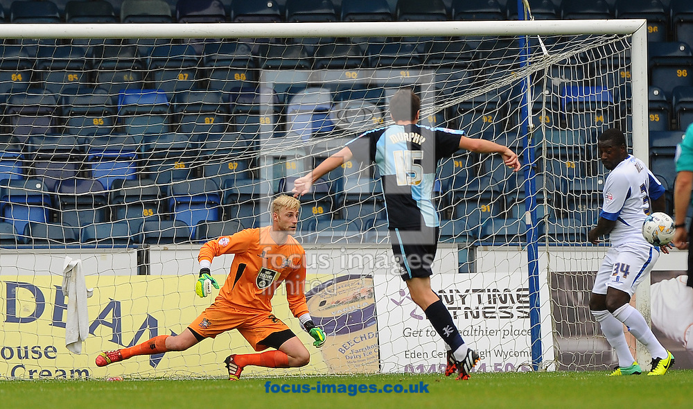 Peter Murphy of Wycombe Wanderers takes a shot but it is blocked by Pablo Mills of Bury during the Sky Bet League 2 match at Adams Park, High Wycombe<br /> Picture by Seb Daly/Focus Images Ltd +447738 614630<br /> 06/09/2014