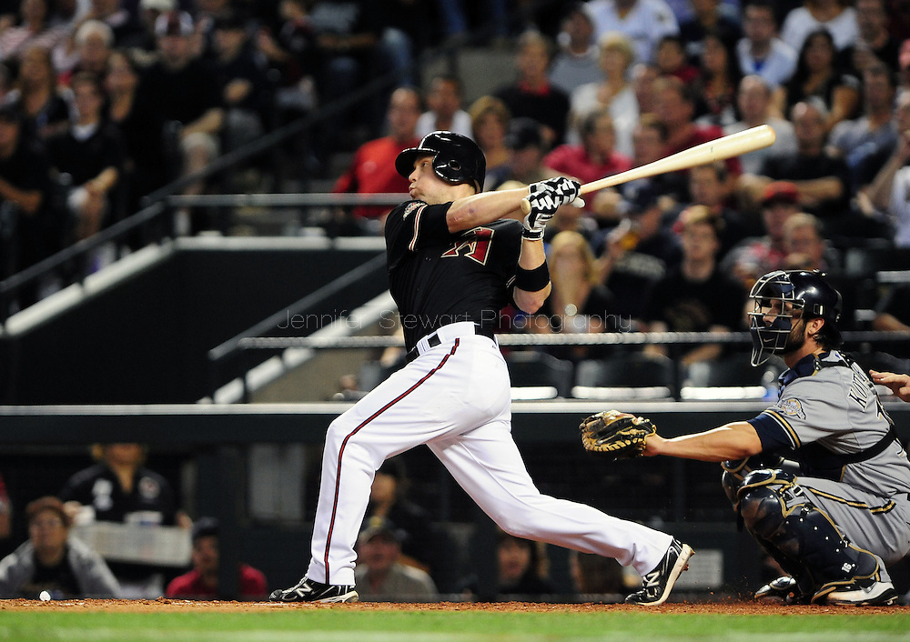 Oct. 5 2011; Phoenix, AZ, USA; Arizona Diamondbacks infielder Aaron Hill (2) hits a solo home run during the sixth inning against the Milwaukee Brewers at game four of the 2011 NLDS at Chase Field. Mandatory Credit: Jennifer Stewart-US PRESSWIRE.