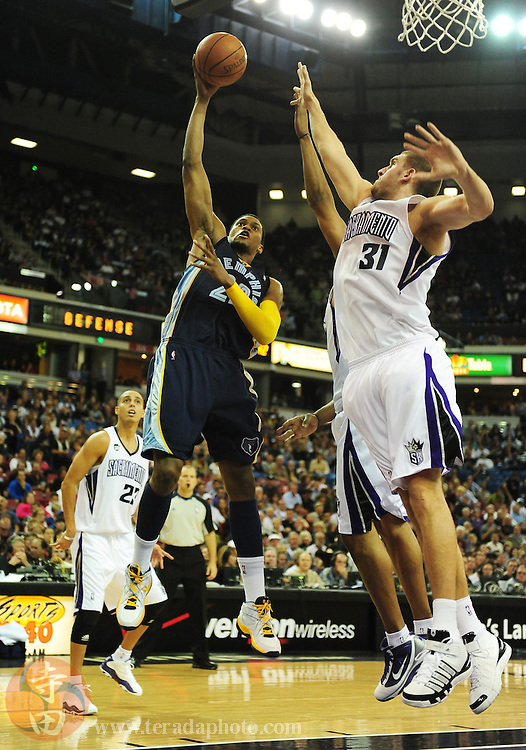 November 2, 2009; Sacramento, CA, USA; Memphis Grizzlies forward Rudy Gay (22) shoots over Sacramento Kings center Spencer Hawes (31) during the second quarter at Arco Arena. Mandatory Credit: Kyle Terada-Terada Photo