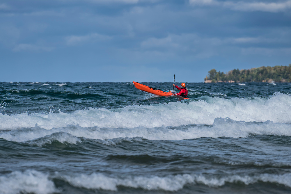 Sea kayaking in waves on Lake Superior on Michigan's Upper Peninsula.