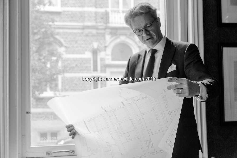 Interior architectThierry THENAERS studies some drawings with daylight coming in, in his office in Brussels, Belgium,  on the 10 th of June 2013. Credit Sander de Wilde for The Wall Street Journal.  Castle
