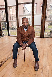 © Licensed to London News Pictures. 29/10/2015. Bristol, UK. Sanctum by THEASTER GATES (pictured).  The artist has built a performance space inside the ruins of a bombed out Temple Church, Temple Street, in central Bristol. The artist has sought out discarded and dormant materials from former places of labour and religious devotion across Bristol to build an intimate and distinctive temporary structure at Temple Church. From 6pm on Thursday 29th October, Sanctum will host a continuous programme of sound over 552 hours until Saturday 21st November, sustained by performers, musicians and bands, spoken word artists and the visiting casts of theatre productions in Bristol. Visitors will be able to enter Sanctum day and night, but the schedule will always remain secret. Visitors won't know who they are about to hear. Produced by international arts producers Situations, in partnership with English Heritage, Sanctum is the first public project in the UK by Chicago-based artist Theaster Gates and forms part of the cultural programme for Bristol 2015 European Green Capital supported by Arts Council England. Photo credit : Simon Chapman/LNP