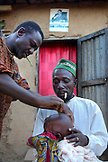 Benin, Djougou November 28, 2006 - The ceremony have a process of initiation is of great social importance and the rites of the ritual have special symbolic meanings. Scarification is used as a form of initiation into adulthood, beauty and a sign of a village, tribe, and clan.