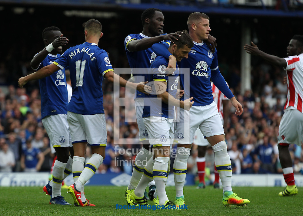 Leighton Baines of Everton celebrates with Romelu Lukaku and Ross Barkley after scoring the penalty goal against Stoke City during the Premier League match at Goodison Park, Liverpool.<br /> Picture by Michael Sedgwick/Focus Images Ltd +44 7900 363072<br /> 27/08/2016