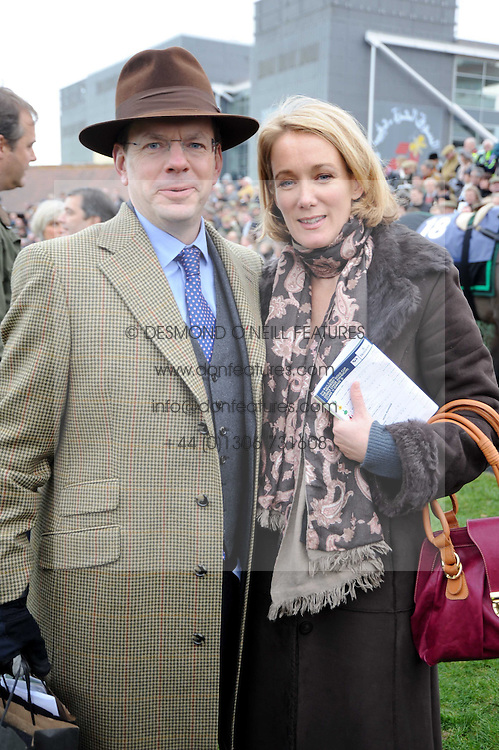JAMES BAKER and his wife ANASTASIA at the Hennessy Gold Cup 2009 held at Newbury Racecourse, Berkshire on 28th November 2009.