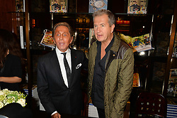 Left to right, VALENTINO GARAVANI and MARIO TESTINO at a party to celebrate the launch of the Maison Assouline Flagship Store at 196a Piccadilly, London on 28th October 2014.  During the evening Valentino signed copies of his new book - At The Emperor's Table.