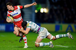 Gloucester Fly-Half (#10) Freddie Burns is tackled by London Irish Lock (#4) George Skivington during the second half of the match - Photo mandatory by-line: Rogan Thomson/JMP - Tel: Mobile: 07966 386802 05/01/2013 - SPORT - RUGBY - Kingsholm Stadium - Gloucester. Gloucester Rugby v London Irish - Aviva Premiership.