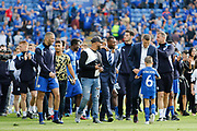 Leicester City squad and staff including Leicester City defender Wes Morgan, Leicester City forward Islam Slimani and Leicester City defender Robert Huth parade around the pitch after  during the Premier League match between Leicester City and Bournemouth at the King Power Stadium, Leicester, England on 21 May 2017. Photo by Richard Holmes.