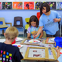 050114       Cable Hoover<br /> <br /> Gallup Catholic School students Mindy Puckett, right, Iliana Andrade and others work on their art projects during a workshop with artist Irving Toddy at Gallup Catholic School Thursday.